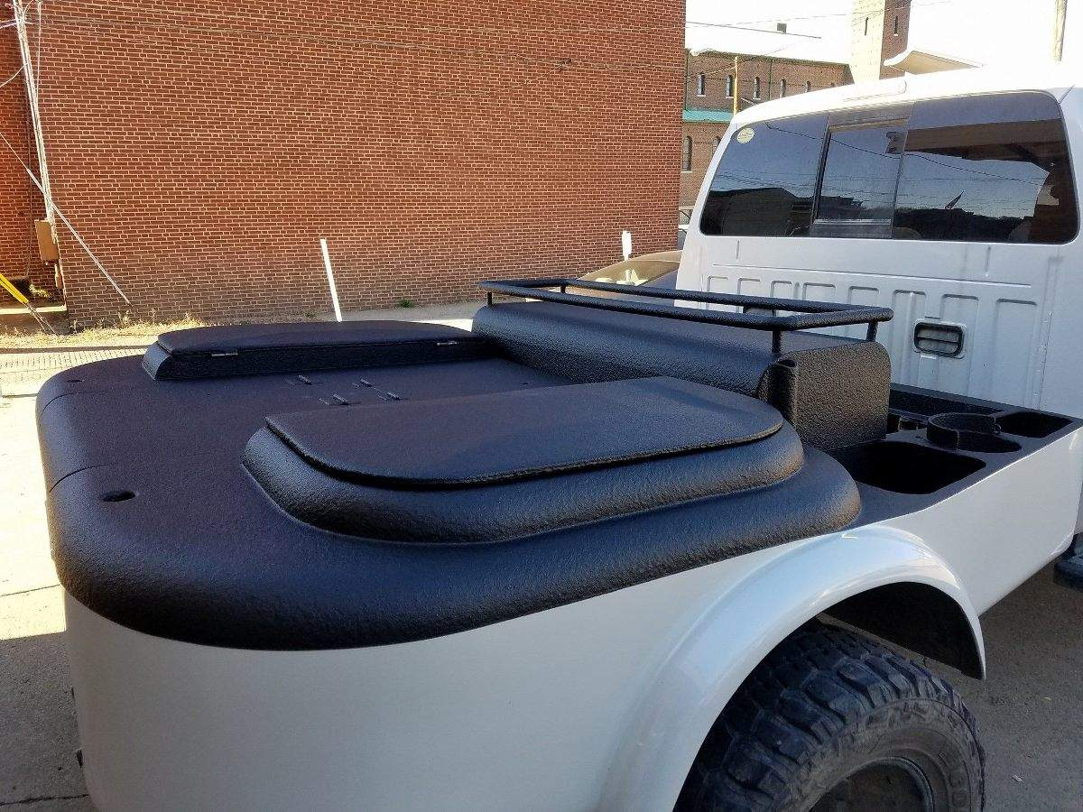 Ford F-350 welding rig coated in ArmorThane spray on bedliner.jpg