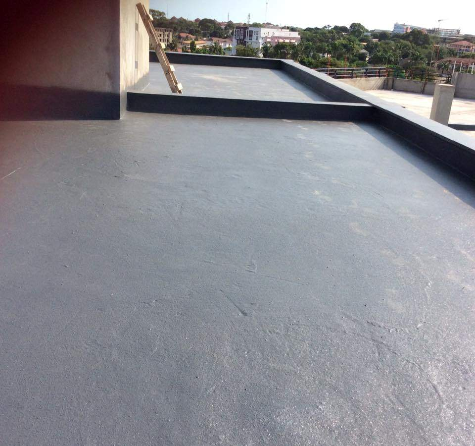 Armorthane Ghana coating the roof decks at Hospital 2.jpg