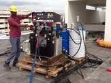 Loading ArmorThane equipment to building roof 2.JPG thumbnail