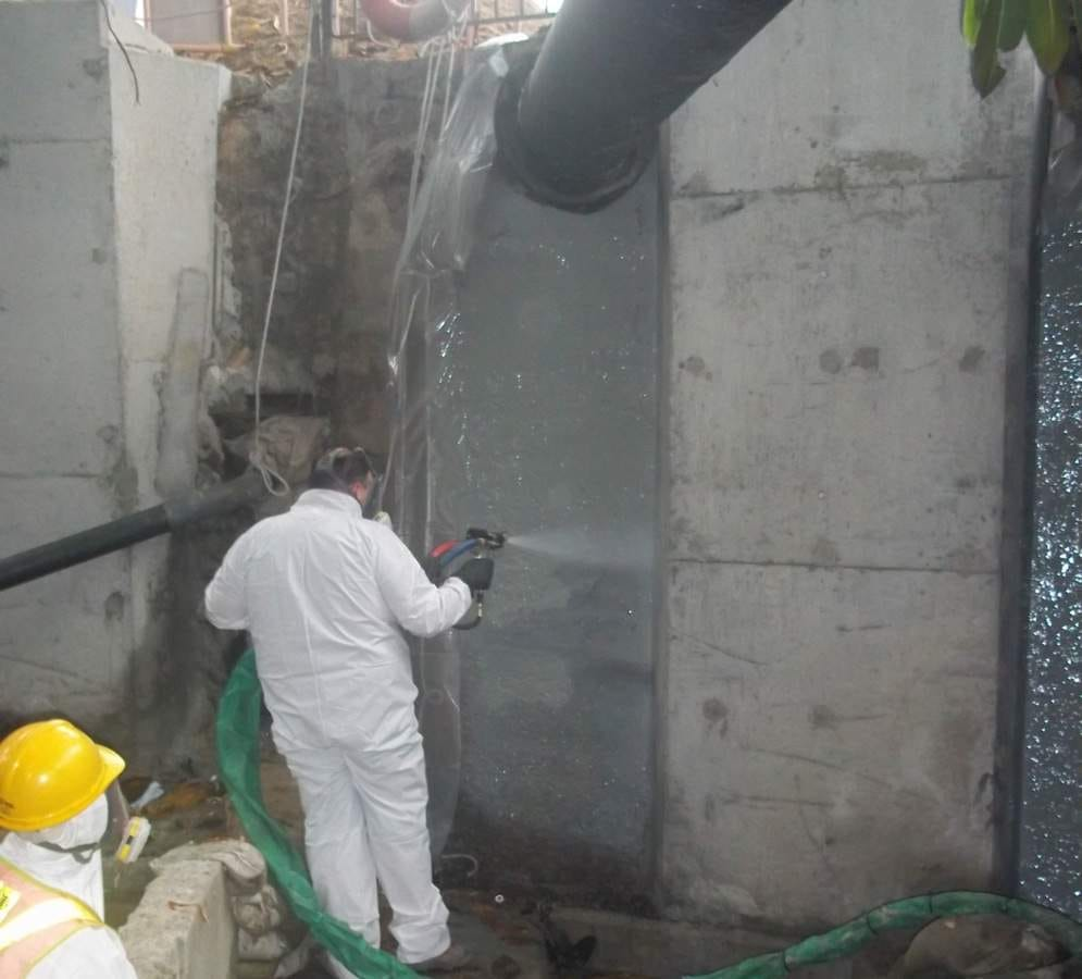 Spraying concrete wall with ArmorThane.jpg