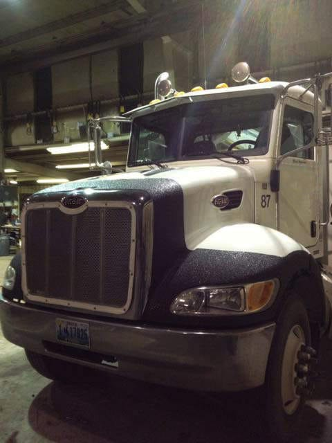 Big rig with bedliner type front protection.jpg