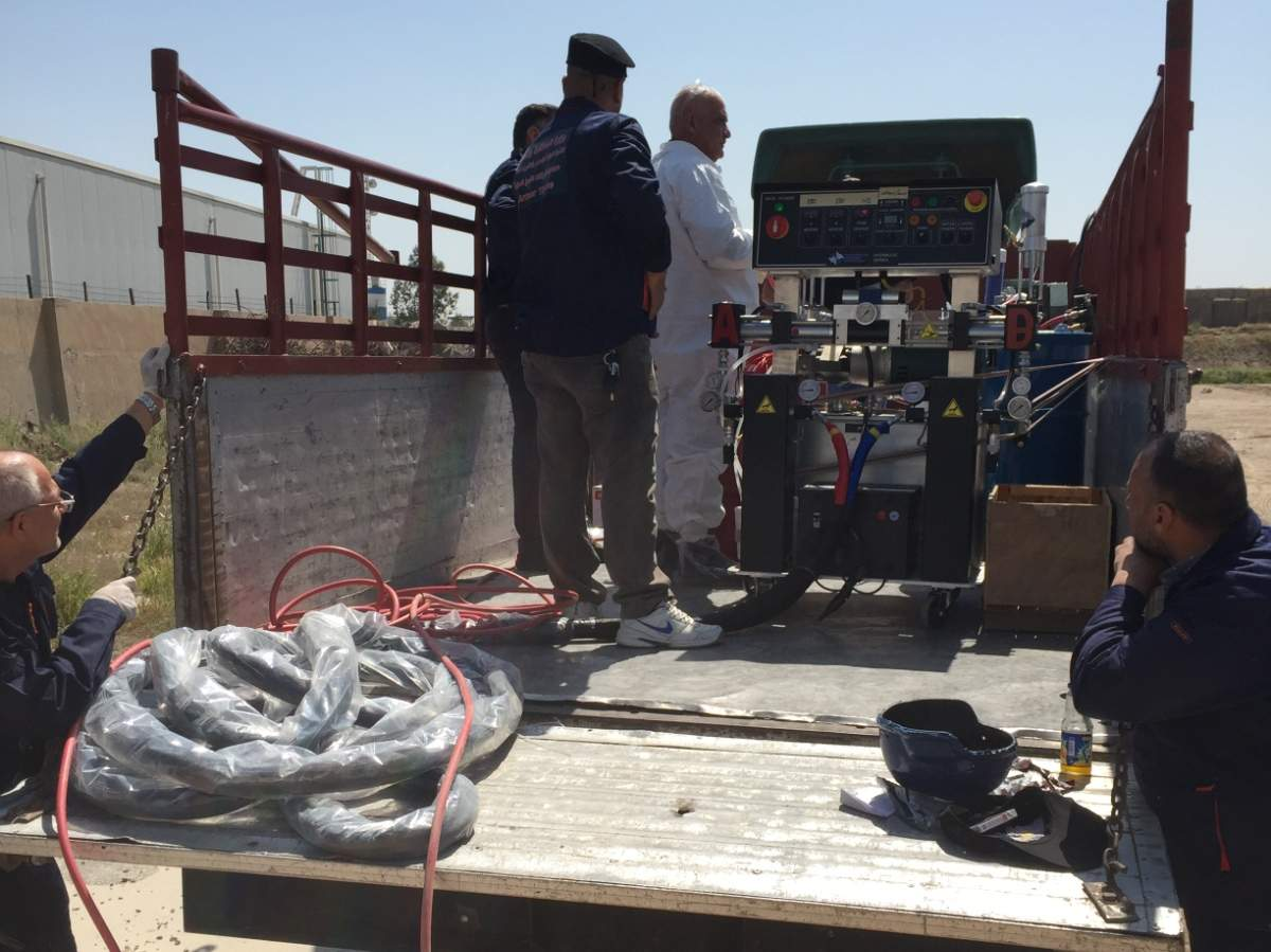 Setting up ArmorThane spray equipment in Bagdad.JPG