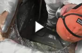 Video spraying sewer manhole