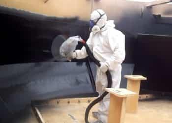 Spray coating water tank with polyurethane