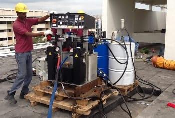 Setting up ArmorThane high pressure spraying equipment