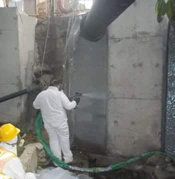 Spraying culvert to demonstrate techniques
