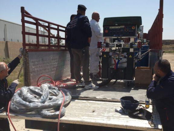 Setting up ArmorThane spray equipment in Bagdad
