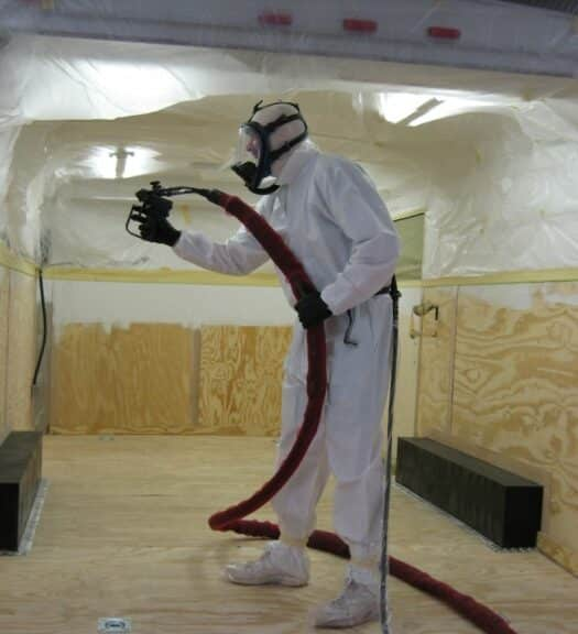 Spraying ArmorThane coating inside trailer