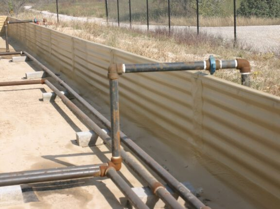 Secondary containment ArmorThane and geotextile combo