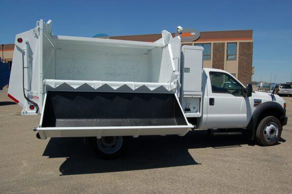Trash truck coating