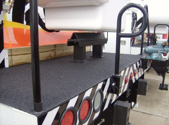 Utility truck slip resistant coating